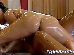 Oil wrestling lesbian babes fingering slits